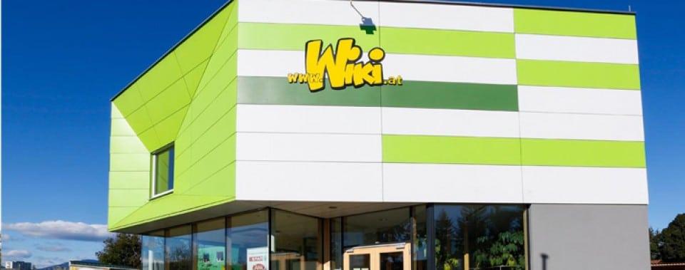 Kinderkrippe Wiki mit grünen und weißen Eternit Fassadenplatten.