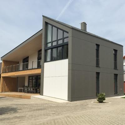 Einfamilienhaus Lienhart mit Et. Wandverkleidung.